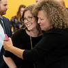 Globe/Roger Nomer<br /> Stephanie Theis, executive director of Children's Haven of Southwest Missouri, is congratulated by Renee White, founder of Children's Haven, on Wednesday after winning the Annie Baxter award at Missouri Southern.