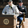 Brig. Gen. James M. AuBuchon addresses the crowd during Memorial Day ceremonies on Monday at the  Pittsburg State University Veterans Memorial. Looking on is PSU Army ROTC Cpt. Chad Murrow.<br /> Globe | Laurie Sisk