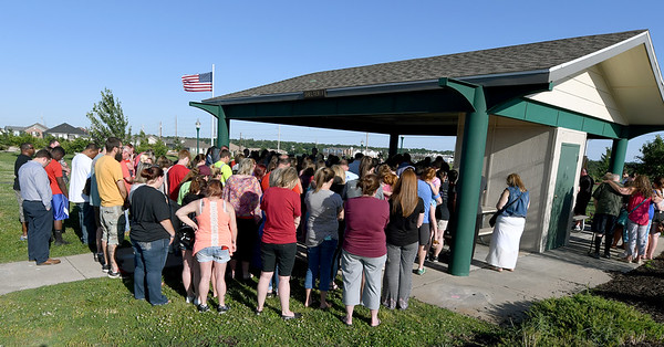 Classmates, family members and members of the Joplin community gather Tuesday night at Cunningham Park as they show support and offer their prayers for 12-year-old Brooke Robinson, who was still missing after a floating accident on Monday.<br /> Globe | Laurie Sisk