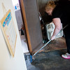 Globe/Roger Nomer<br /> Stephanie Quick tears up flooring on Monday in her home in Neosho.