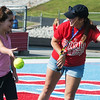 Globe/Roger Nomer<br /> Alex Parker, Webb City High junior and incoming student council president, helps Katelyn Coleman, a fourth grader at Carterville Elementary with the softball toss on Tuesday during the Cardinal Track and Field Day for special olympians at Cardinal Stadium. Following the weather cancellation of the Southwest Missouri Special Olympics spring games, Parker, along with the junor and senior high student councils and members of the community, helped organize the field day for Webb City area special olympians.