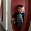Globe/Roger Nomer<br /> Brody Gage, 8, reads at the new children's library on May 18.