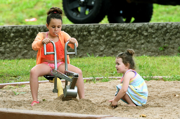 From the left: Eight-year-old Olivia Williams and three-year-old Kyleigh Williams check out the sand box at Schermerhorn Park in Galena on Tuesday.<br /> Globe | Laurie Sisk