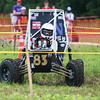 Globe/Roger Nomer<br /> A driver runs through the dirt of the maneuverability course on Saturaday during the Baja SAE Kansas event at Pittsburg State.