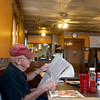 Globe/Roger Nomer<br /> Richard Giles, Diamond, reads before breakfast on Wednesday at Mary Lee's Cafe.