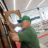 Globe/Roger Nomer<br /> Bruce Seesengood checks on a clock at the new Joplin Public Library on Tuesday afternoon. Seesengood helped move this clock, donated to the library by Bunny Newton, and a grandfather clock from the old library to the new one.