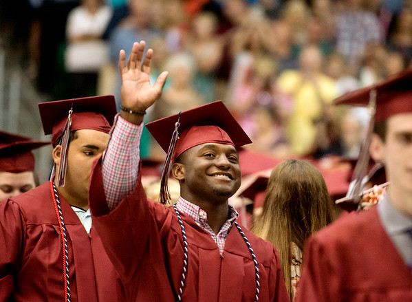 Globe/Roger Nomer<br /> Joplin High graduate Terrell Crawford waves to his family as he enters the Leggett and Platt Athletic Center on Sunday for graduation.