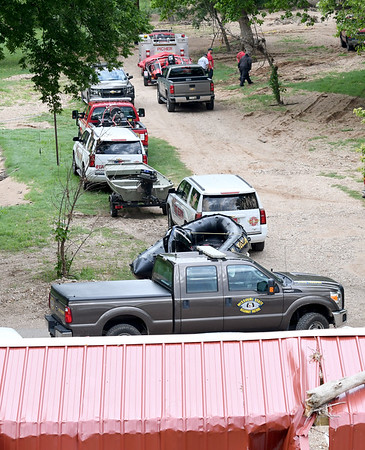 Numerous agencies, including the Missouri Highway Patrol, Newton County Sheriffs Department, Redings Mill Fire Department and both Quapaw Tribe and Picher Fire Departments join in the search  for 12-year-old Brooke Robinson, who was swept away in Shoal Creek on Monday.<br /> Globe  Laurie Sisk