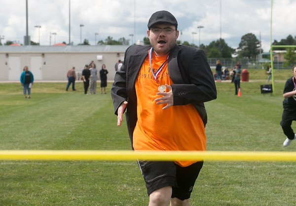Globe/Roger Nomer<br /> Brett Kohler runs for the finish line on Wednesday during Easy Living's Champions Day at the Joplin Athletic Complex. Easy Living serves adults with disabilities and plans to make the games an annual event.