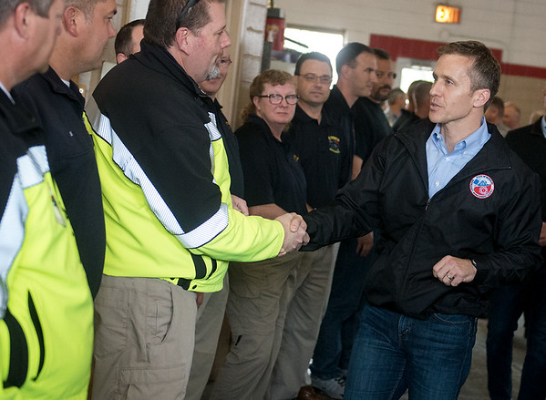 Globe/Roger Nomer<br /> Missouri Gov. Eric Greitens meets with Newton County first responders on Monday during a stop at the Neosho Fire Station.