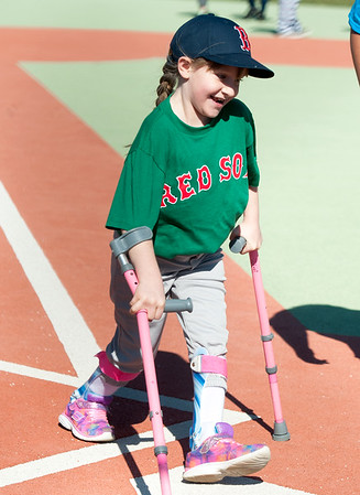 Eight-year-old Meghan Tackett, of Galena, smiles as she scores a run for her Red Sox team during Miracle League action on Saturday at the Will Norton Field of Dreams.<br /> Globe | Laurie Sisk