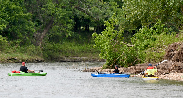 From the left: Aaron and Josh Patrum of Cullman, Ala., and Danny Patrum, of Joplin, search for extended family member, 12-year-old Brooke Robinson, who was swept away in Shoal Creek on Monday. <br /> Globe  Laurie Sisk