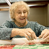 Jo Stocker clips a tie while working on a quilt on Thursday at the First United Methodict Church in Carthage.<br /> Globe | Laurie Sisk