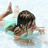 Two-year-old waterbug Alyssa Thrash joins the large crowds in celebrtaion of Opening Day at Schifferdecker Pool on Monday.<br /> Globe | Laurie Sisk