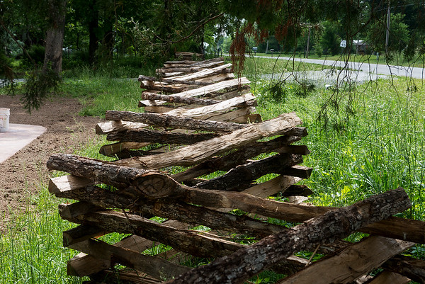 Globe/Roger Nomer<br /> A split-rail fence lines the property at the Rader Farm.