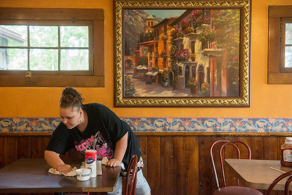 Globe/Roger Nomer<br /> Danielle Greene, assistant manager, clears a table on Wenesday at Mary Lee's Cafe.