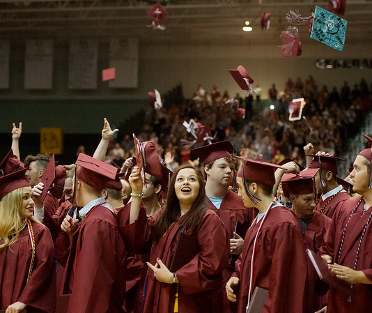 Globe/Roger Nomer<br /> Guadalupe Banda tosses her hat with fellow Joplin graduates on Sunday.