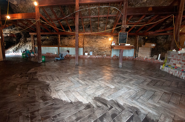 Workers install new flooring on Wednesday during remodeling of The Undercliff, a popular restaurant that will be reopening in Tipton Ford.<br /> Globe | Laurie Sisk