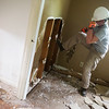 Globe/Roger Nomer<br /> Jacki Temple, Pittsburgh, Pa., kicks out drywall on Wednesday in a house in Neosho while volunteering with Team Rubicon.