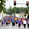 On Saturday, runners in the 2017 Joplin Memorial 5k make their way through memorials on Joplin Street for the 161 people who died in the May, 2011 tornado.<br /> Globe | Laurie Sisk
