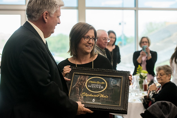 Globe/Roger Nomer<br /> Stephanie Theis, executive director of Children's Haven of Southwest Missouri, accepts the Annie Baxter award from Missouri Southern President Alan Marble on Wednesday at MSSU.