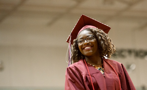 Globe/Roger Nomer<br /> Raina Taylor smiles at Joplin High teachers after she receives her diploma on Sunday.