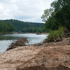 Globe/Roger Nomer<br /> The shore along the Elk River shows damage from recent floods in Noel.