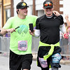 From the left: Blake and Conrad Webster record their half marathon finish on a smart phone on Saturday at the Joplin Memorial Marathon.<br /> Globe | Laurie Sisk