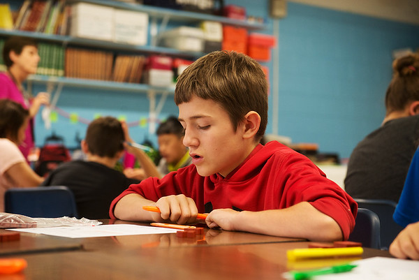 Globe/Roger Nomer<br /> Kolten Lewis, fifth grade, works on a math problem at Jasper Elementary on Tuesday.