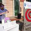 Stephen Gilman, marketing director for Compassionate Care Senior Services, readies his pie toss booth during Third Thursday in downtown Joplin. Proceeds from the event will benefit the Walk to End Alzheimers, which will be Aug. 21.<br /> Globe | Laurie Sisk