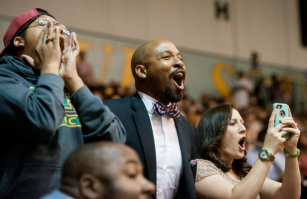 Globe/Roger Nomer<br /> (from left) Juliano Roper, cousin, Otis Roper II, father, and Erin Roper, step-mother, cheer for Othellis Roper III as he graduates from Joplin High on Sunday at the Leggett and Platt Athletic Center.