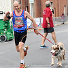 "Henri Coeme and his marathon partner, ""Miles"" run the full marathon on Saturday at the Joplin Memorial Marathon.<br /> Globe 