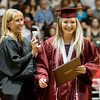 Globe/Roger Nomer<br /> Joplin School Board member Jennifer Martucci FaceTimes fellow board member Lori Musser from Italy so she can see Emmy Drouin receive her diploma on stage on Sunday. Musser is best friends with Drouin's mother.