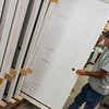 Globe/Roger Nomer<br /> Terry Booth, Habitat for Humanity Restore manager, moves doors from a recent donation on Friday.