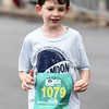 Six-year-old Henry Bresee makes his way to the finish line during the 5k on Saturday at the Joplin Memorial Marathon.<br /> Globe | Laurie Sisk