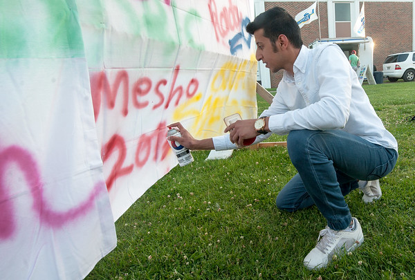Missouri Southern junior Meshari Alnefaie, of Riyadh, Saudia Arabia, leaves his mark on a makeshift graffiti wall during Spring Finals Madness at the Student Life Center on Friday night. Students enjoyed carnival games, music and a late night breakfast at the event, which marks the end of the Spring semester.<br /> Globe | Laurie Sisk