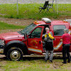 Divers from the Picher Fire Department join in the search for 12-year-old Brooke Robinson, who was swept away in Shoal Creek on Monday.<br /> Globe  Laurie Sisk