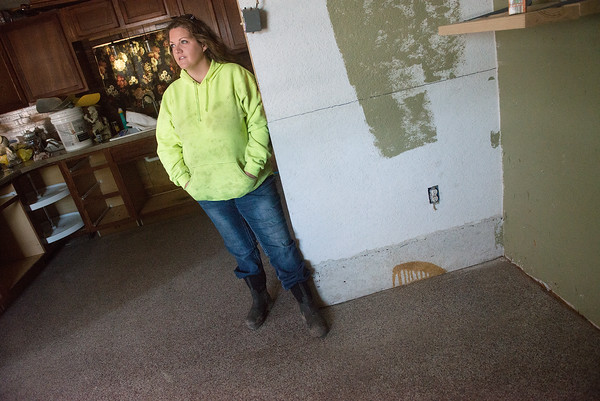 Globe/Roger Nomer<br /> Libby Snethen talks about flooding in her home in Kendricktown on Tuesday.