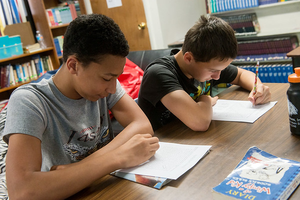 Globe/Roger Nomer<br /> Noah Neher, left, and Mitchell Alvalos, sixth grade, study on Tuesday at Jasper Elementary.