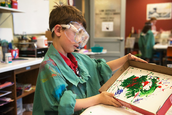 Globe/Roger Nomer<br /> Aaden Walker, 6, uses a marble to make his action painting on Tuesday at Spiva Center for the Arts.