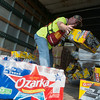 Globe/Roger Nomer<br /> Robert Cooper, Springfield, unloads supplies from the American Red Cross on Monday at the Lampo Building in Neosho.