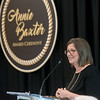 Globe/Roger Nomer<br /> Stephanie Theis, executive director of Children's Haven of Southwest Missouri, accepts the Annie Baxter award on Wednesday at Missouri Southern.