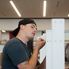 Globe/Roger Nomer<br /> Taylor Hall, of NEO Cabinets, assembles book shelves at the new Joplin Public Library on Thursday. The shelves at the new library are built lower than the previous shelves to be more accessible.