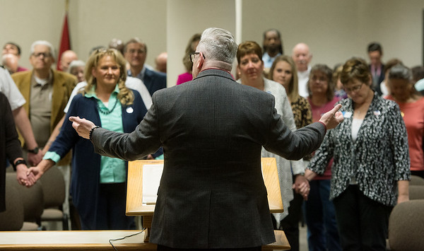 Globe/Roger Nomer<br /> Daniel Wermuth, pastor at the Joplin Family Worship Center and chairman of the Joplin Area Ministerial Alliance, leads a prayer during Thursday's National Day of Prayer at Joplin City Hall.