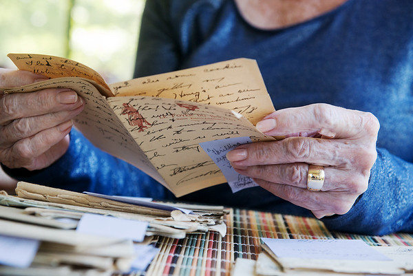 Globe/Roger Nomer<br /> Gwen Hunt looks through the letters of a WWI veteran on Thursday in Webb City.