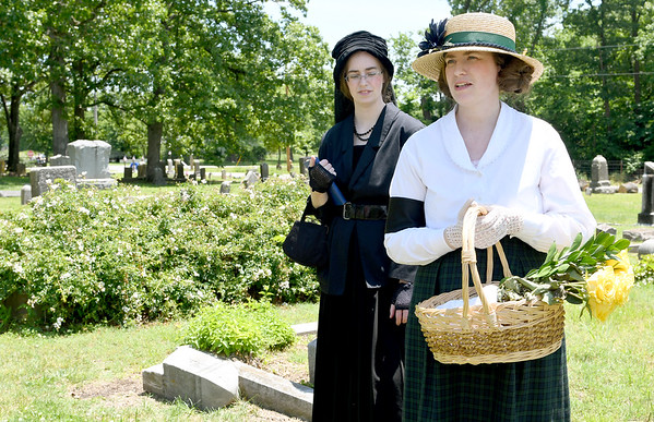 From the left: Historical reeanctors Kay and Emily Ellis describe life in the World War I era during a walkthrough Memorial of WWI soldiers on Memorial Day at the Carterville Cemetery.<br /> Globe | Laurie Sisk