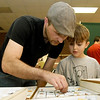 From the left: Leighton Cordell and his eight-year-old son Julius Bachman-Cordell, check out rocks at the Tri-State Gem and Mineral Society's 11th Annual Spring Rock Swap on Saturday at the Joplin Historical and Mineral Museum.<br /> Globe | Laurie Sisk