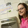 Globe/Roger Nomer<br /> Breklyn Shelley, a fifth grader at Royal Heights Elementary, poses with one of her posters promoting her water project on Friday.