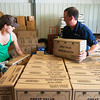 Globe/Roger Nomer<br /> Ruth Sawkins, race director,  and Brock Cummins unload water for one of the 19 hydration stations for the Joplin Memorial Run on Tuesday at Forest Park Baptist Church.