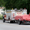 Rescue crews from Picher, Okla. arrive to aid in the search for 12-year-old Brooke Robinson, who was swept away in Shoal Creek on Monday.<br /> Globe  Laurie Sisk